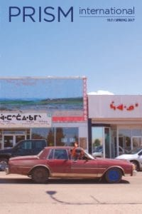 Prism International cover: issue 55.3 Spring 2017, photograph of old, red car in front of storefronts on a sunny day, people waving from car