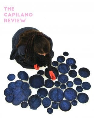TCR The Capilano Review cover: 3.28 Winter 2016; woman kneeling in front of a group of blue circles on the ground