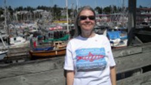 Delores Broten photographed in front of marina