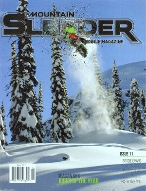 Mountain Sledder Snowmobile Magazine cover: issue 11 2017, Reagan Sieg, Rider of the year, action photograph pf snowcapped mountain top and trees with air-borne rider