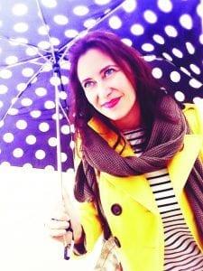 Felice Bisby headshot with umbrella