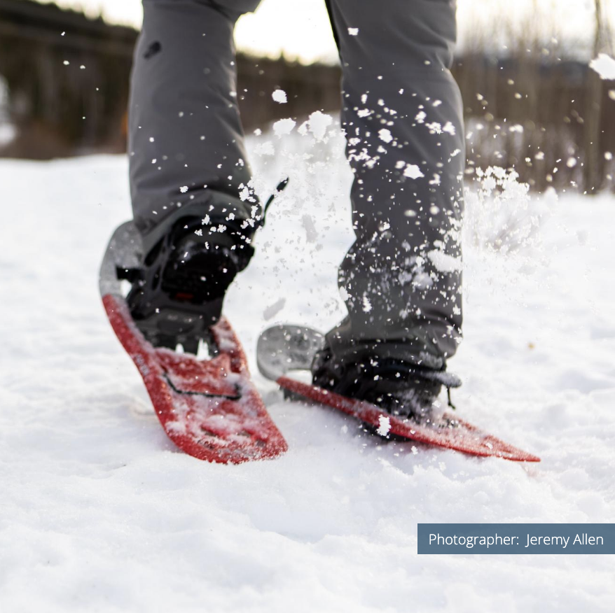 Close-up of walker with red snowshoes from behind. Photographer: Jeremy Allen.
