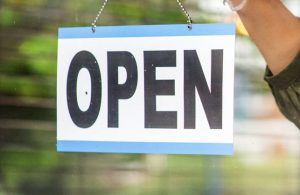 Open sign with part of arm