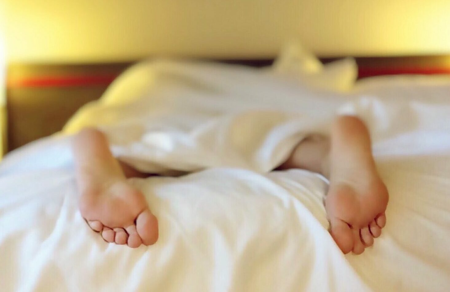 Feet poking out of bed